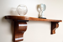 Walnut curved mantel with traditional corbels